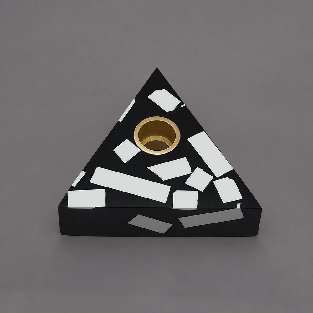 Each candle holder is hand made from black Jesmonite with graphic white chips. It has a fixed brass insert. Designs come packaged within a branded box. Subtle variations of white chip arrangement makes each piece unique. Product dimensions: 11cm x 11cm x 3cm Candle not included.