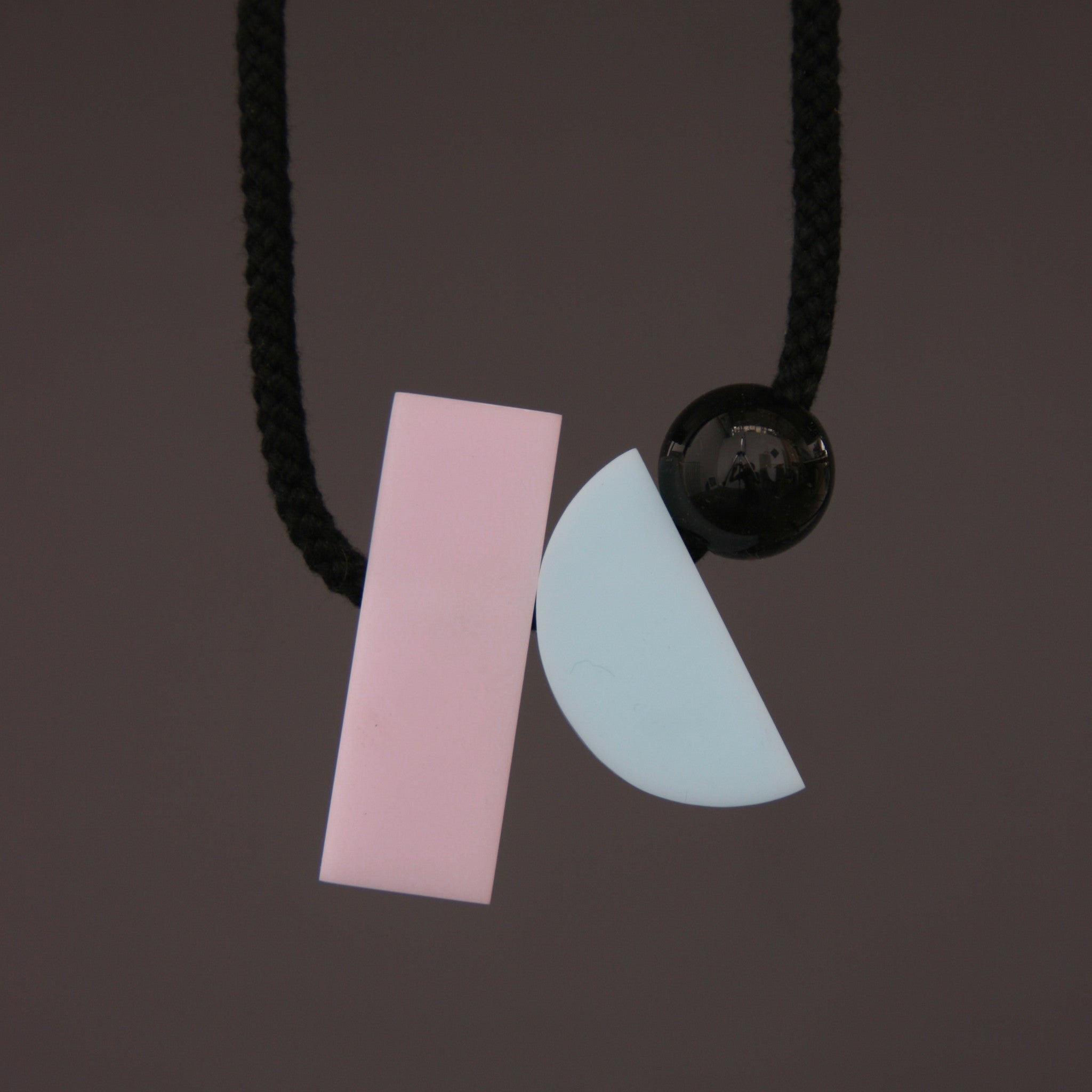 Dora is a fresh minimal and stylish necklace. The pastel colours and geometric shapes look great against a simple top. It hangs really nicely. Dora is composed of 3 parts. A pink rectangular resin section (70mm x 23mm), a pale blue resin curve (50mm x 23mm) and a small black resin ball (25mm).