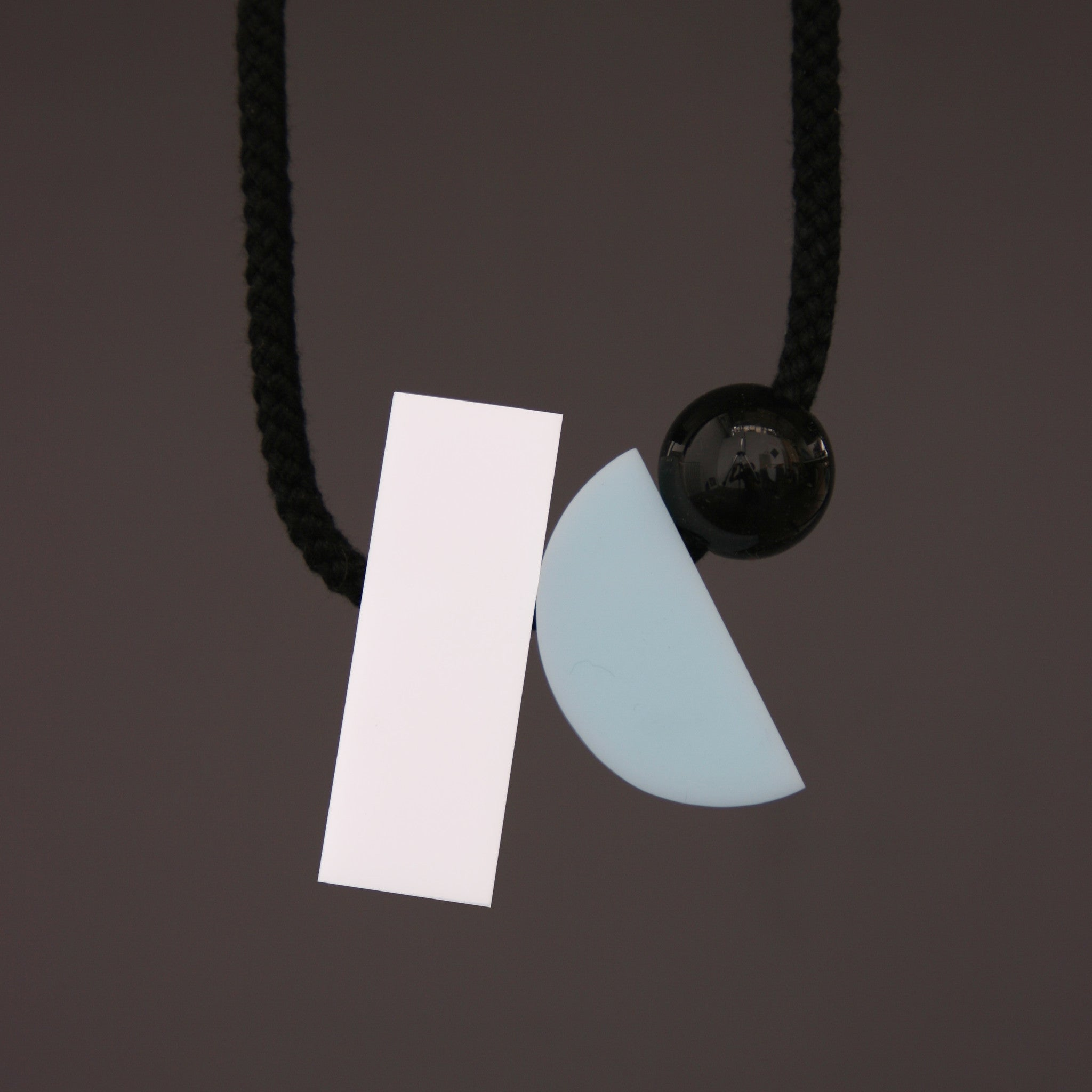 Image of Dora necklace with a white rectangle rather than pink.  Contemporary geometric necklace.