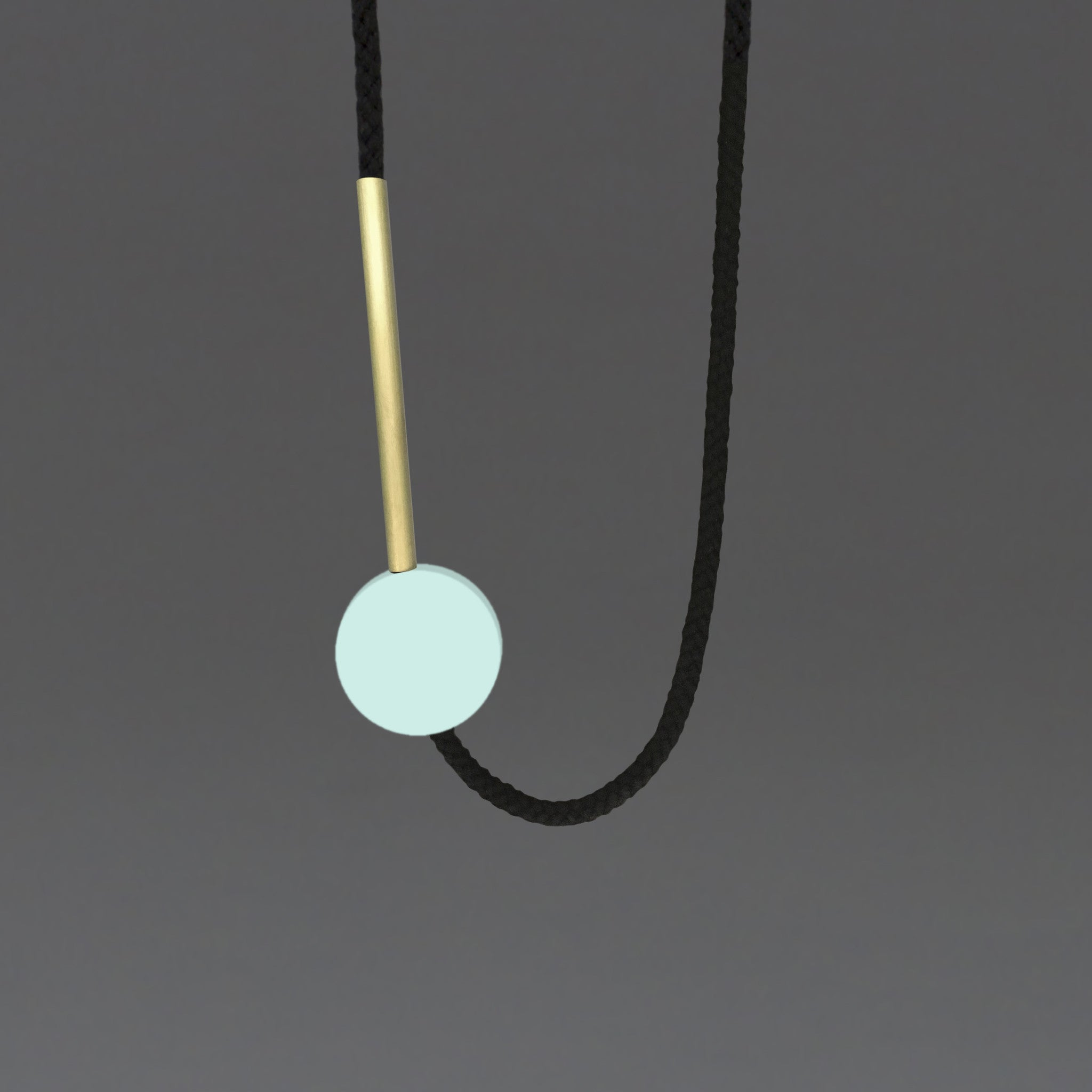 The Gia necklace is a pared down and striking design. Composed of a perfect mint resin circle and a 10cm brass tube. Cord length is fully adjustable using the little wooden ball at the back of the neck. This necklace can work both on a casual outfit or in a smarter look too. Handmade in our London studio.