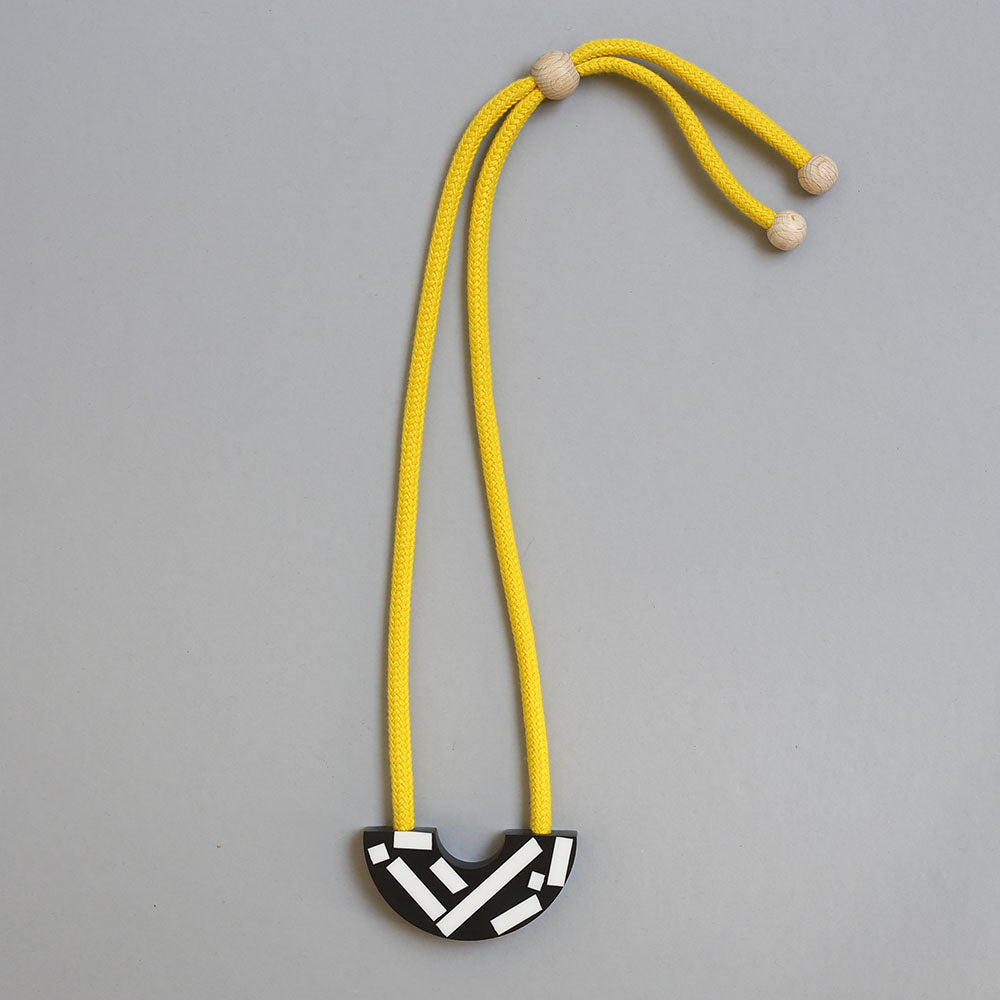 Say hello to our new Ito necklace! This handcast necklace is available with a yellow, red or blue cord. The black speckled curve is cast by hand in our studio using jesmonite meaning that each necklace is unique. The speckles are bold and white creating a striking design.