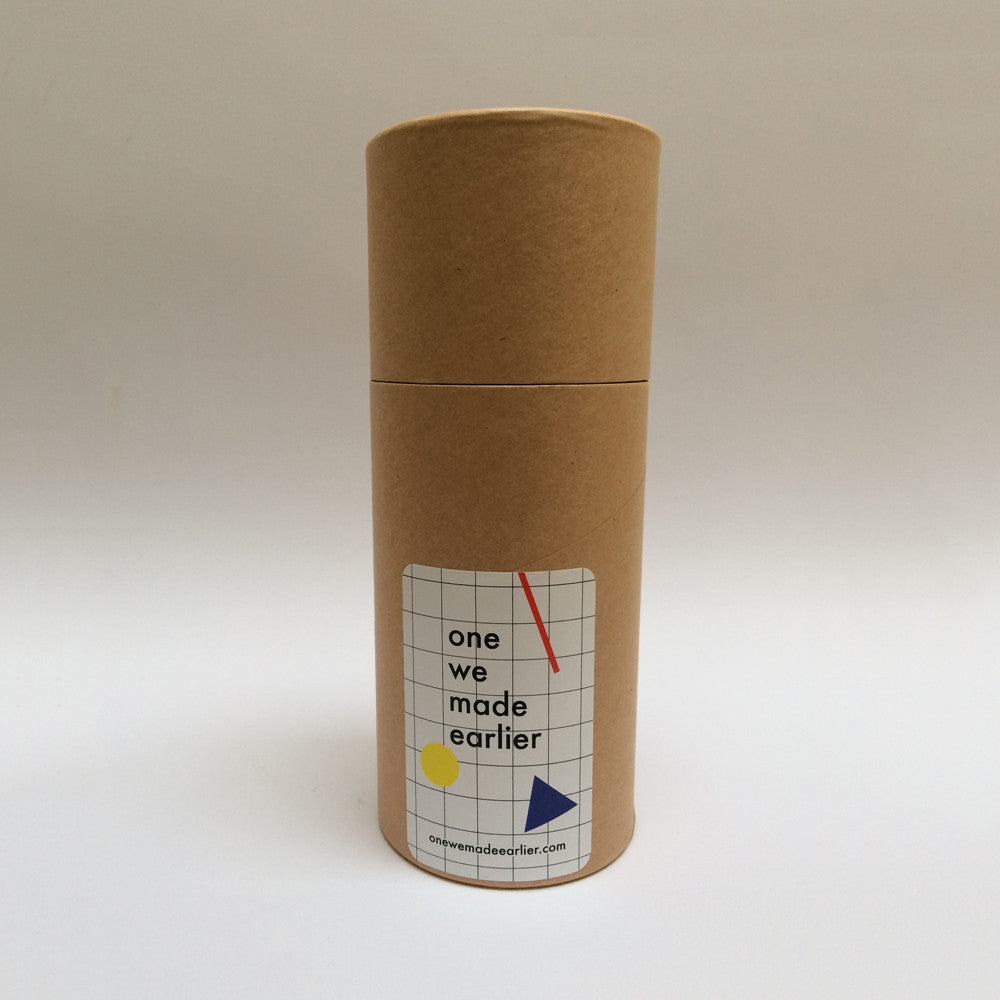 Tube packaging for accessories by One We Made Earlier.