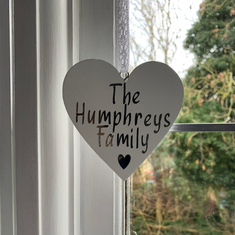 Wooden family name hanging heart