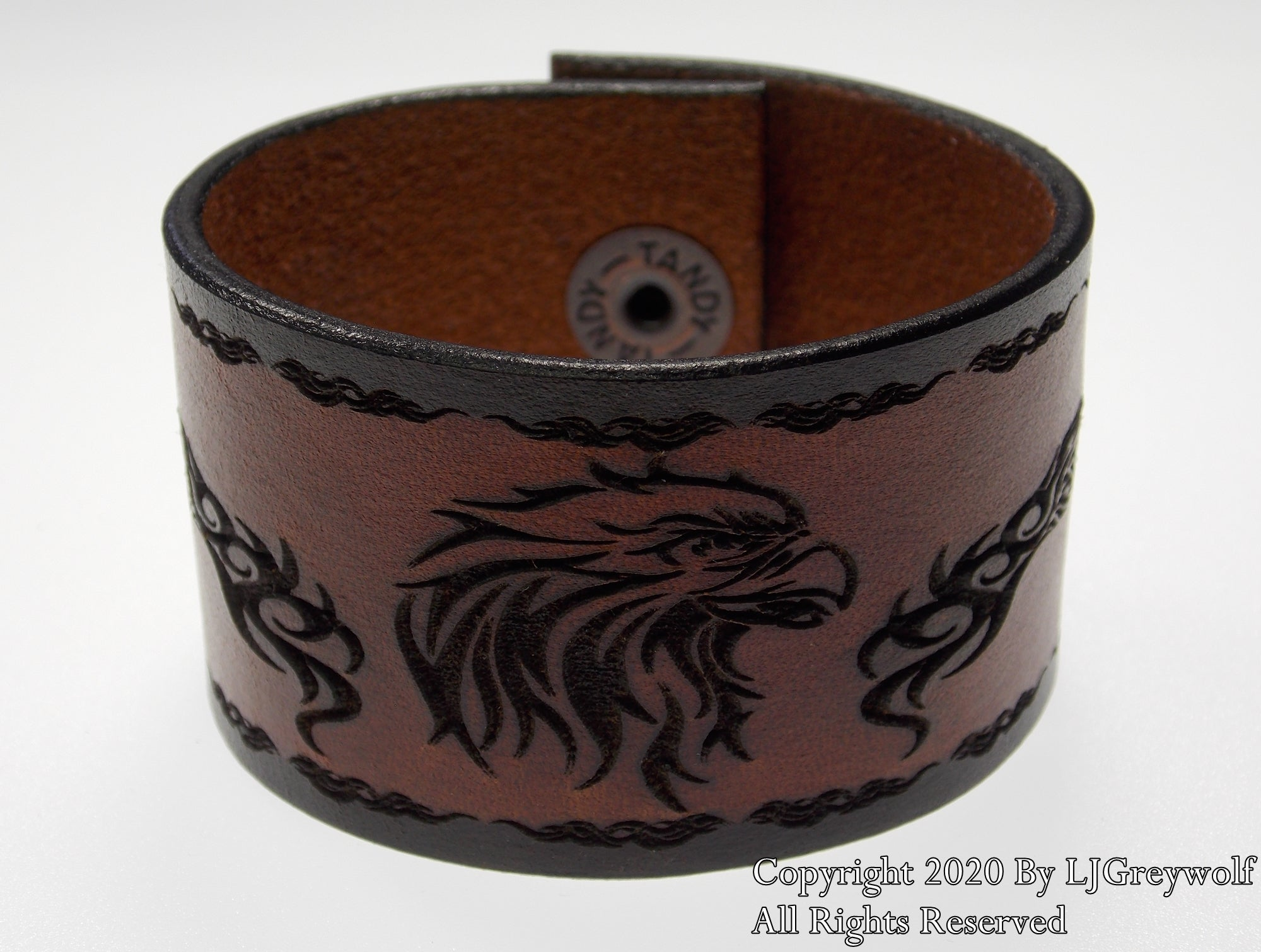 The Tribal Eagle Hand Carved Leather Bracelet In Antique Saddle