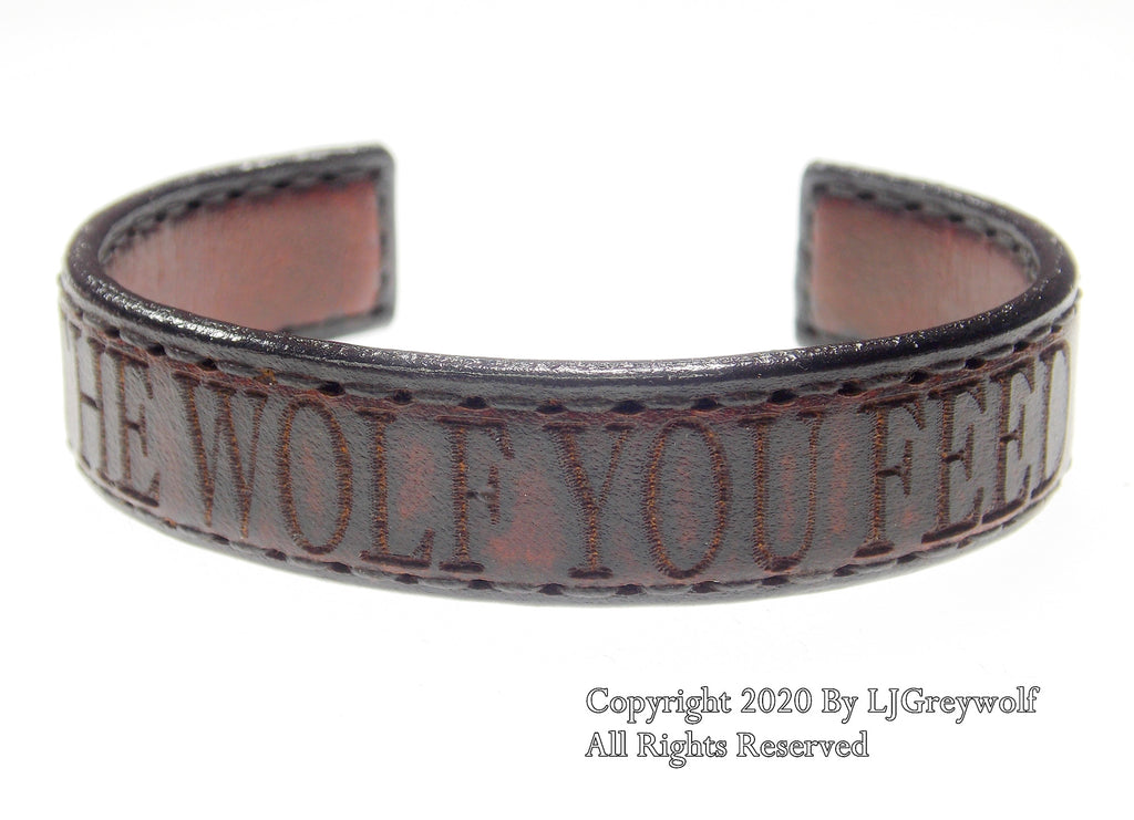 The Wolf You Feed Hand Carved Leather Bracelet In Antique Saddle