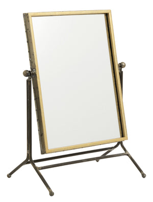 Gold vanity mirror on a stand.