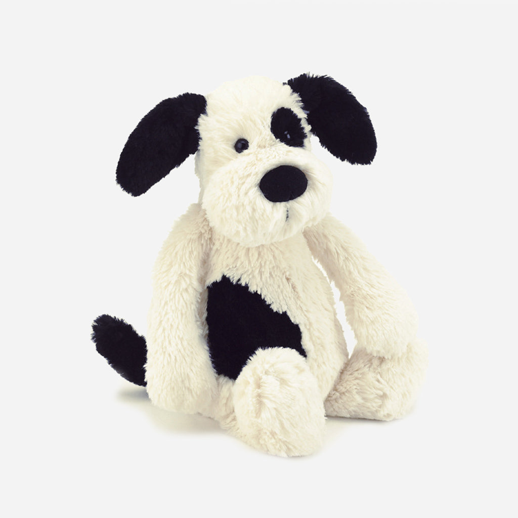 A small, black and white, puppy dog soft toy from Jellycat. With black and white fur, he's suitable from birth, so children and babies alike will love him. Buy online and in store from Jo & Co Home, North Cornwall, UK.