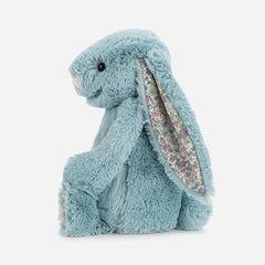 A cuddly, Jellycat medium bunny soft toy. With blue fur and ditsy floral print fabric in her ears, she's suitable from birth. Buy online and in store from Jo & Co Home, North Cornwall, UK