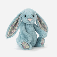 A cuddly, Jellycat medium rabbit soft toy. With blue fur and ditsy floral print fabric in her ears, she's suitable from birth. Buy online and in store from Jo & Co Home, North Cornwall, UK