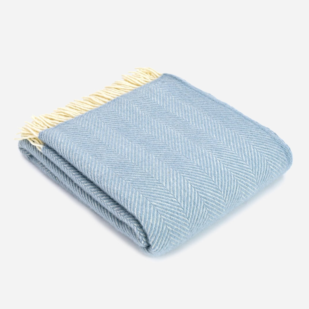 A sky blue and white blanket, made from pure new wool, it features a fishbone pattern. Buy online or shop in store at Jo & Co home, North Cornwall, UK