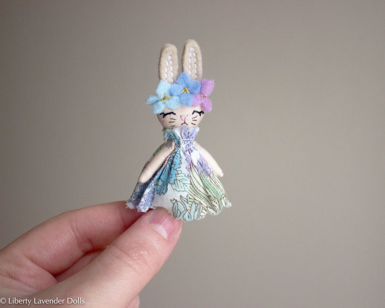 "Itty Bitty Bunny Doll. Miniature decorative cloth doll About 2.6"" inches tall."