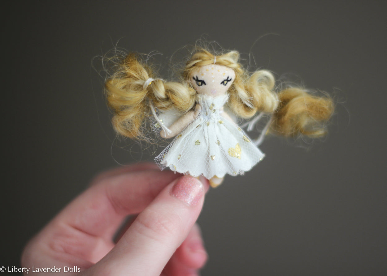 "Itty Bitty Fairy Doll. Miniature decorative cloth doll About 2"" inches tall."