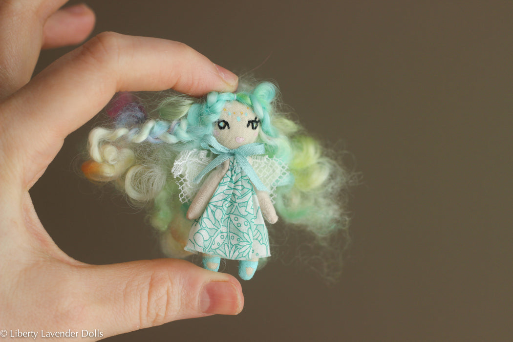 "Miniature Fairy Doll. Tiny decorative cloth doll About 2"" inches tall."