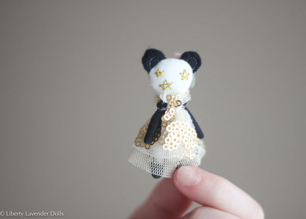 "Miniature Panda Doll. Itty Bitty decorative cloth doll About 2.25"" inches tall."