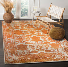 Ivory Beige Orange Color Machine Made Persian style rugs in living room area.