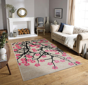 Pink Color Machine Made Persian style rugs by the fireplace in living room area.