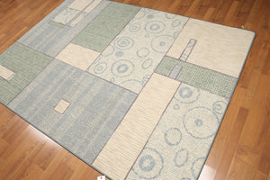 "5'4""x7'8"" Blue, Beige, Green, Multi Color Machine Made Polypropylene Indonesian High Density Hand Carved Effect Modern Oriental Rug With one edge damaged"