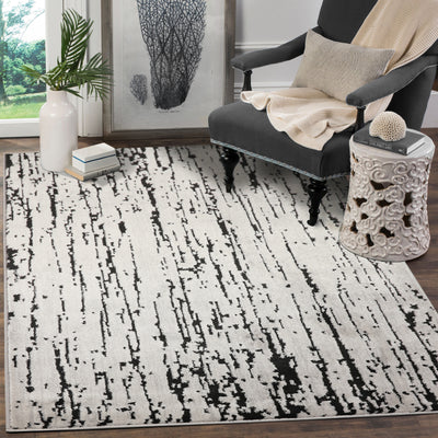Gray Black Color Machine Made Persian style rugs in living area.