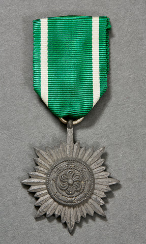 German Decoration for Bravery and Merit of the Eastern People Second Class in Silver, with Original Ribbon