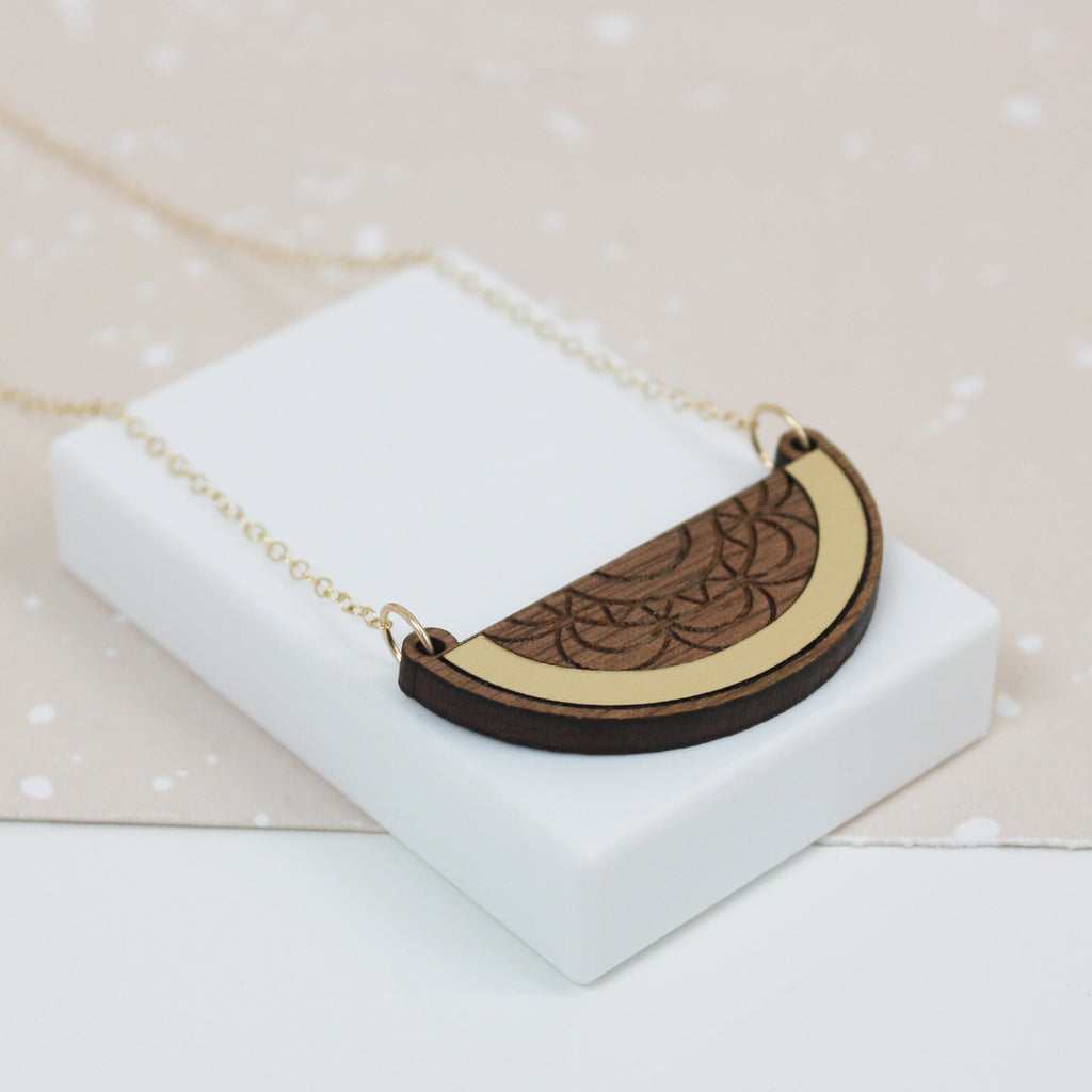 Semicircle walnut necklace with gold inlay