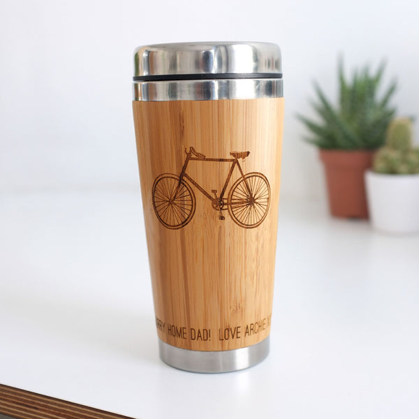 wooden travel mug with bicycle illustration