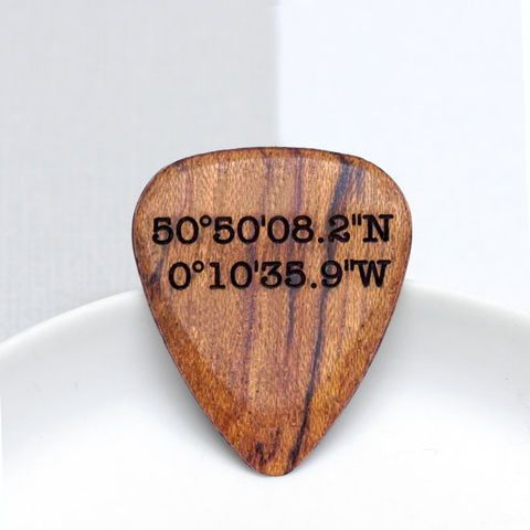 wooden guitar plectrum with coordinates