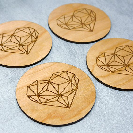 Set of four woodn geometric heart coasters