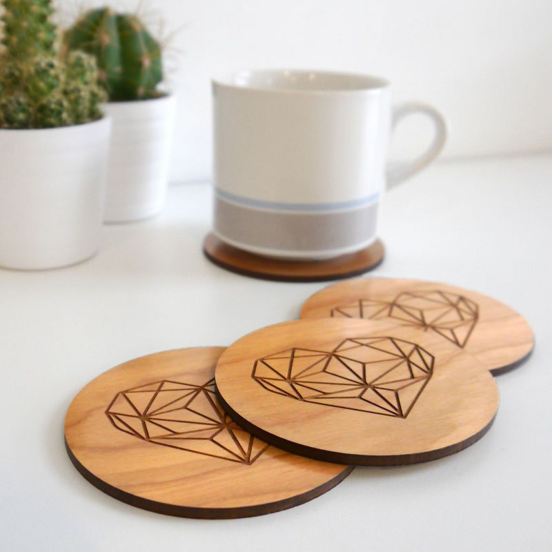 Geometric heart coasters stacked with mug