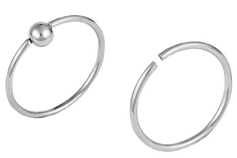 This set of Surgical Steel nose hoops includes a seamless nose hoop and a captive bead ring hoop. Each of the rings is 20 gauge and 10 mm in diameter, and the CBR ring has a 2.5 mm ball. This body jewelry is hypoallergenic.