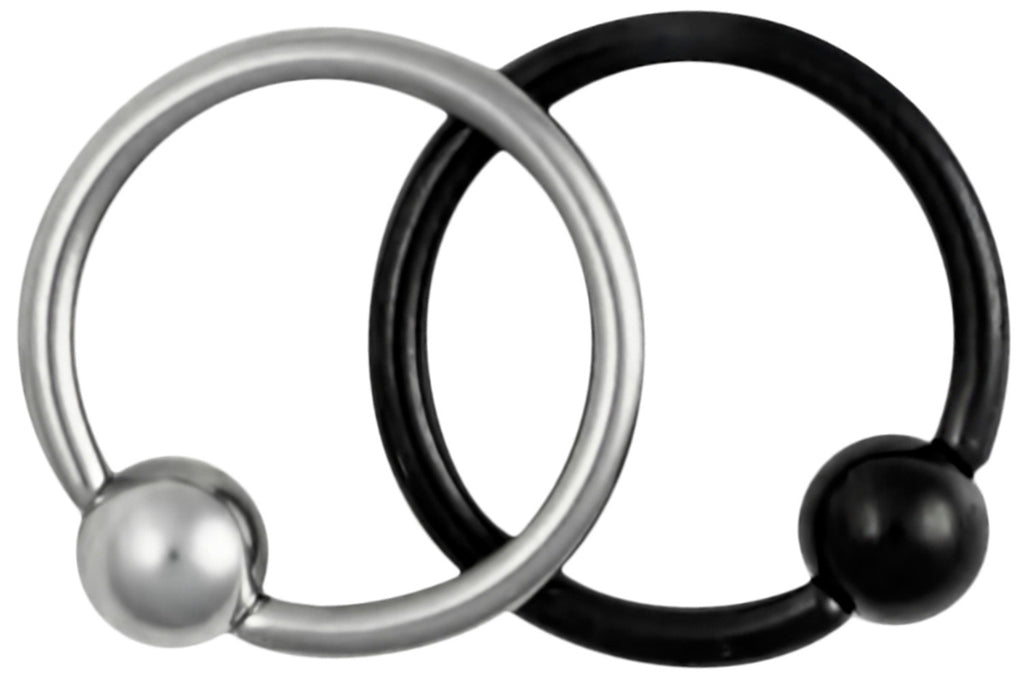 "This set of 18 gauge cartilage jewelry includes a plain steel hoop and a Titanium IP plated black hoop. IP (Ion Plating) is a safe and permanent fusion coating process used to enhance the durability, color and shine of body jewelry. Both pieces of jewelry are made with surgical grade 316L Stainless Steel. These captive bead rings have a 5/16"" (8 mm) diameter and come with a 3 mm ball. Both pieces of body piercing jewelry are hypoallergenic and nickel free."