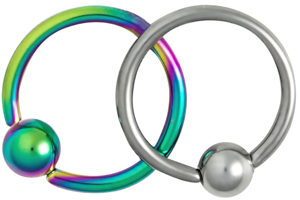 "This set of 18 gauge cartilage jewelry includes a plain steel hoop and a Titanium IP plated rainbow hoop. IP (Ion Plating) is a safe and permanent fusion coating process used to enhance the durability, color and shine of body jewelry. Both pieces of jewelry are made with surgical grade 316L Stainless Steel. These captive bead rings have a 5/16"" (8 mm) diameter and come with a 3 mm ball. Both pieces of body piercing jewelry are hypoallergenic and nickel free."