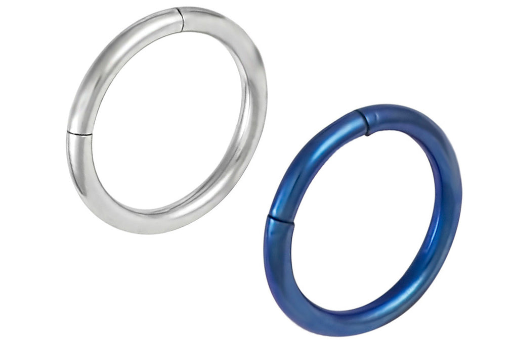 These 16 gauge endless cartilage hoop earrings are made with surgical grade 316L stainless steel. The blue ring is made with Surgical Steel and blue Titanium IP Plating. IP Plating (Ion Plating) is a safe and permanent surface refinishing process that produces a harder, brighter, more durable piece of jewelry. These hoops are 8 mm in diameter.