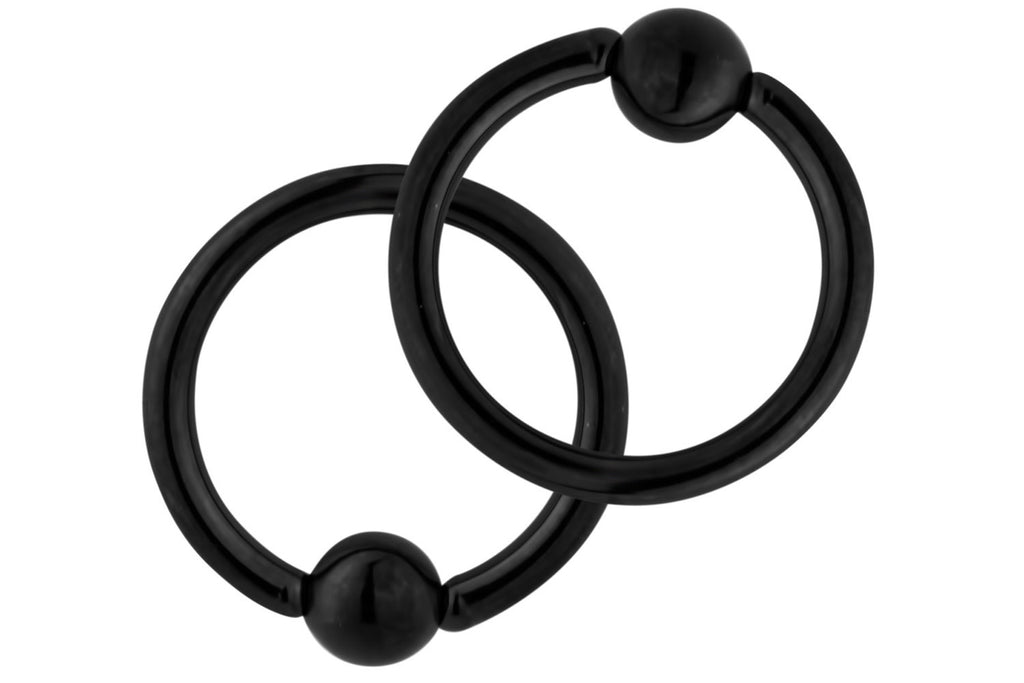 "This pair of 14 gauge CBR ring is made with surgical grade 316L Stainless Steel and black Titanium IP plating. The rings are 3/8"" (10 mm) in diameter with 4 mm balls."