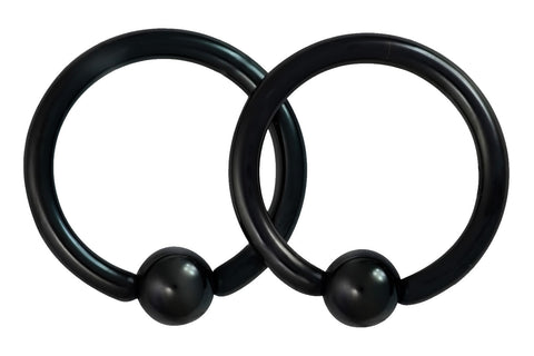 "This pair of 14 gauge CBR ring is made with surgical grade 316L Stainless Steel and black Titanium IP plating. The rings are 7/16"" (11 mm) in diameter with 4 mm balls."