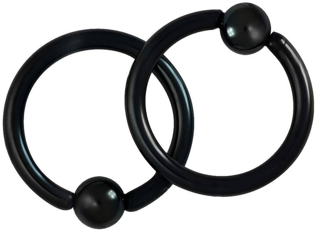 "This pair of 14 gauge CBR ring is made with surgical grade 316L Stainless Steel and black Titanium IP plating. The rings are 1/2"" (12 mm) in diameter with 5 mm balls."