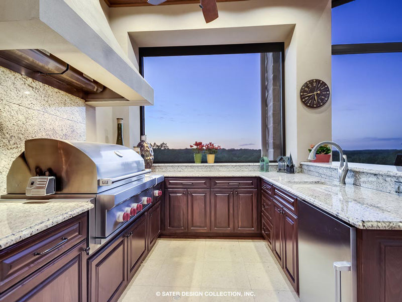 outdoor kitchen on the veranda of a custom home