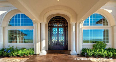 custom front door on a luxury Mediterranean styled house