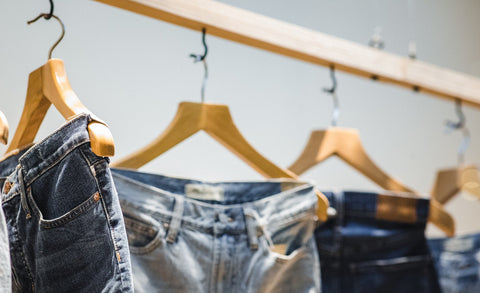 Jeans on a clothing rack
