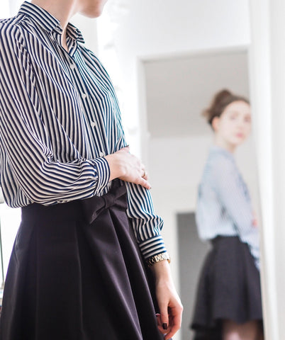 Woman wearing top and skirt