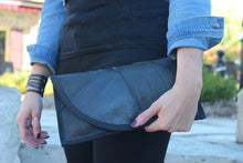 chic made consciously sustainable clutch made from tire inner tubes