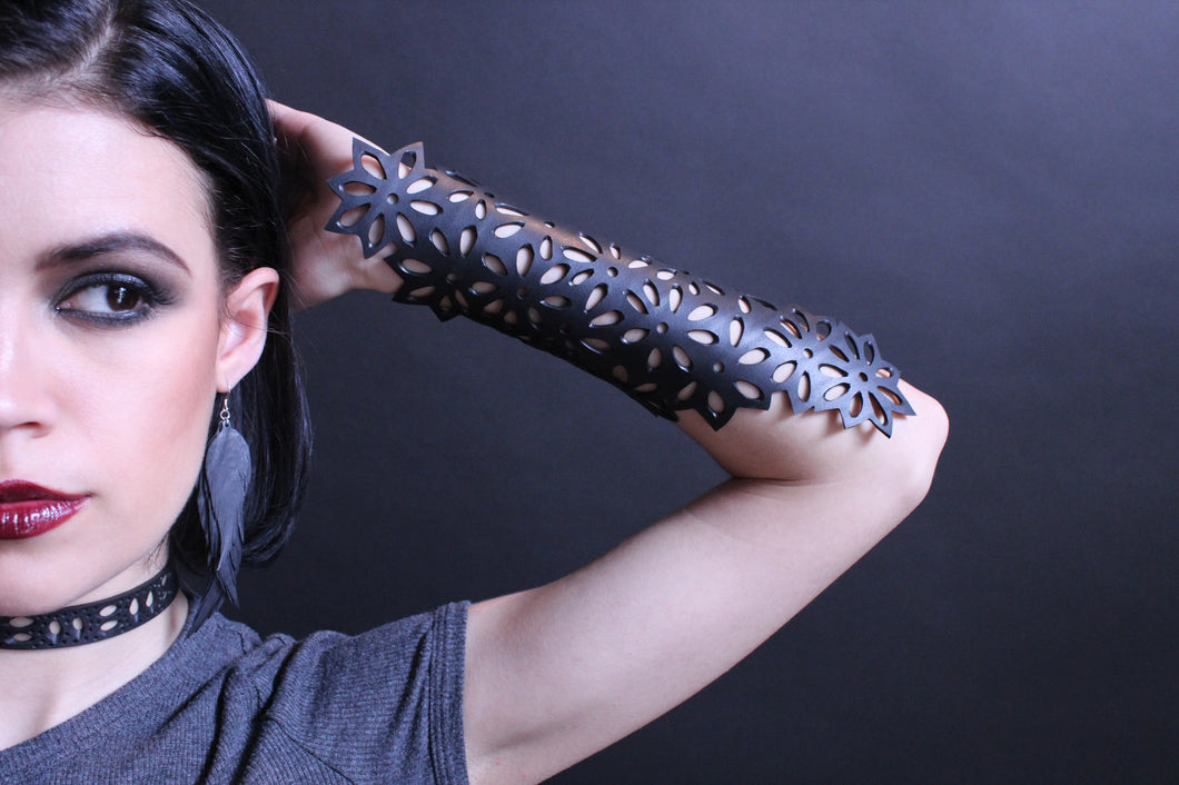chic made consciously eco friendly flower arm tattoo made from tire inner tubes