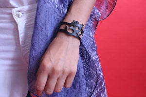 chic made consciously sustainable om bracelet made from repurposed tire inner tubes