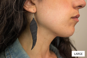 chic made consciously eco friendly feather earrings ethically made in bali