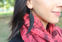 chic made consciously vegan feather earrings made from tire inner tubes