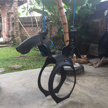 chic made consciously upcycled swing made from recycled tire truck