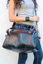 chic made consciously eco friendly versatile bag made from tire inner tubes