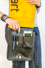 chic made consciously sustainable unisex tablet bag handmade from tire inner tubes