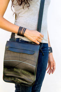 chic made consciously eco friendly unisex tablet bag made from repurposed tire inner tubes