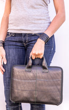 chic made consciously eco friendly business bag made from repurposed tire inner tubes