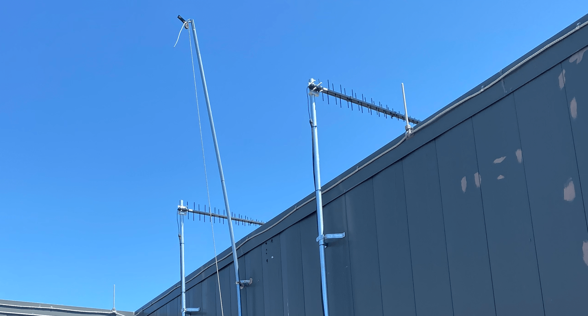 2 Cel-Fi LPDA Antennas Installed Pointing Out From Roof